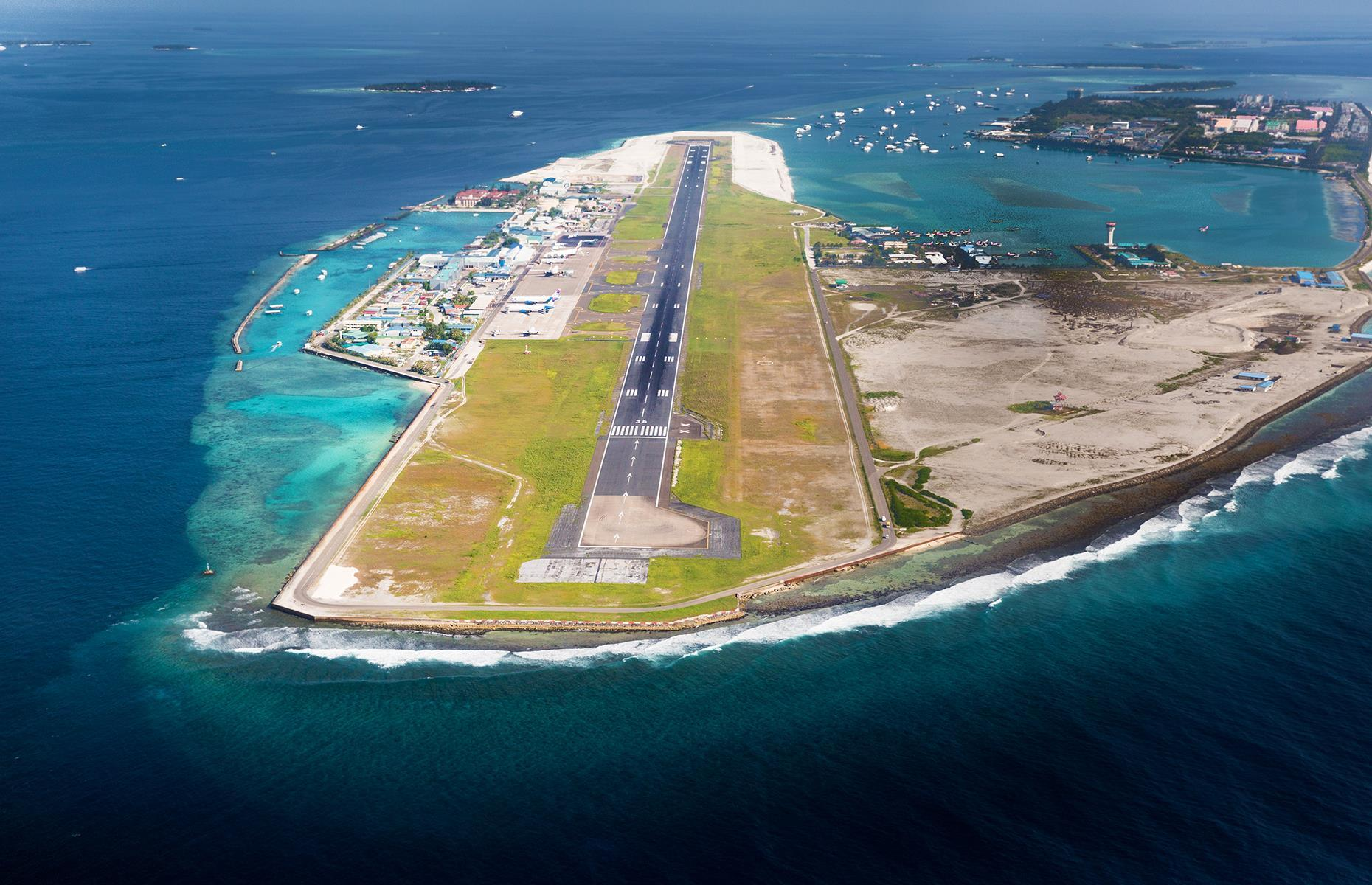 Slide 24 of 31: This is the main international airport for the Maldives, located on Hulhule Island in the North Male Atoll. So if you want to dip your toes in the pristine blue waters, you'll have to stomach the gut-wrenching landing that almost sees the plane take a dip too.