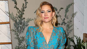 Kate Hudson wearing a blue shirt