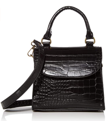 a bag sitting on top of a table: The Drop Diana Top Handle Crossbody Bag