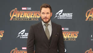 Chris Pratt wearing a suit and tie