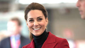Catherine, Duchess of Cambridge wearing glasses and smiling at the camera