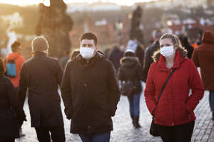 a group of people standing in the snow: Coronavirus Treatment