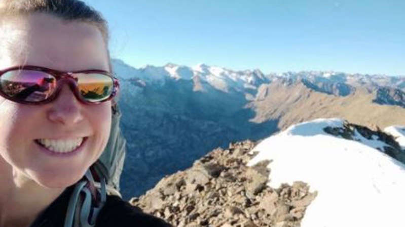 a person wearing sunglasses and standing in front of a mountain: Ms Dingley, 37, had been walking solo in the mountains near the Spanish and French border