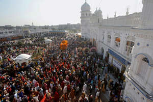 Sikh pilgrims attend a religious festival to celebrate the birth anniversary of their spiritual leader Baba Guru Nanak Dev, at Nankana Sahib, near Lahore, Pakistan, Monday, Nov. 30, 2020. Thousands of pilgrims from various countries arrived in Pakistan to participate in three-day festival to celebrate the 551st birth anniversary of the founder of the Sikh religion. (AP Photo/K.M. Chaudary)