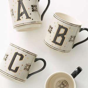 a coffee mug on a table: Anthropologie Tiled Margot Monogram Mug