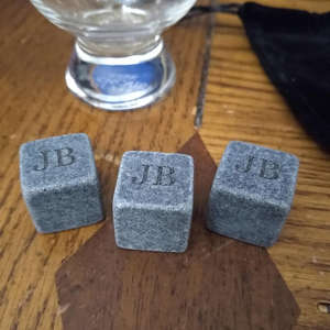 a wooden table: Whiskey Stones