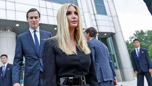 Jared Kushner, Ivanka Trump standing next to a person in a suit and tie