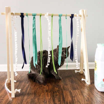 Slide 8 of 31: Why spend a ton of money on dog or cat toys when you can pull one together with a few dollar store finds? This idea can be crafted with a few pieces of wood, ribbon, and string.See photo on Instagram