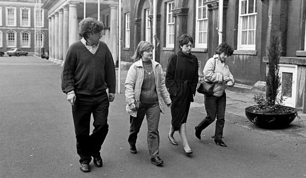 a couple of people that are standing in the street: Joanne Hayes and her sister Kathleen (second, left) and brother Ned arriving for the hearing at the Kerry Babies Tribunal in 1985. Pic: Eamonn Farrell/RollingNews.ie