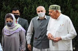 a group of people standing around each other: Jammu & Kashmir: Gupkar Alliance leaders to attend all-party meet called by PM Narendra Modi on June 24