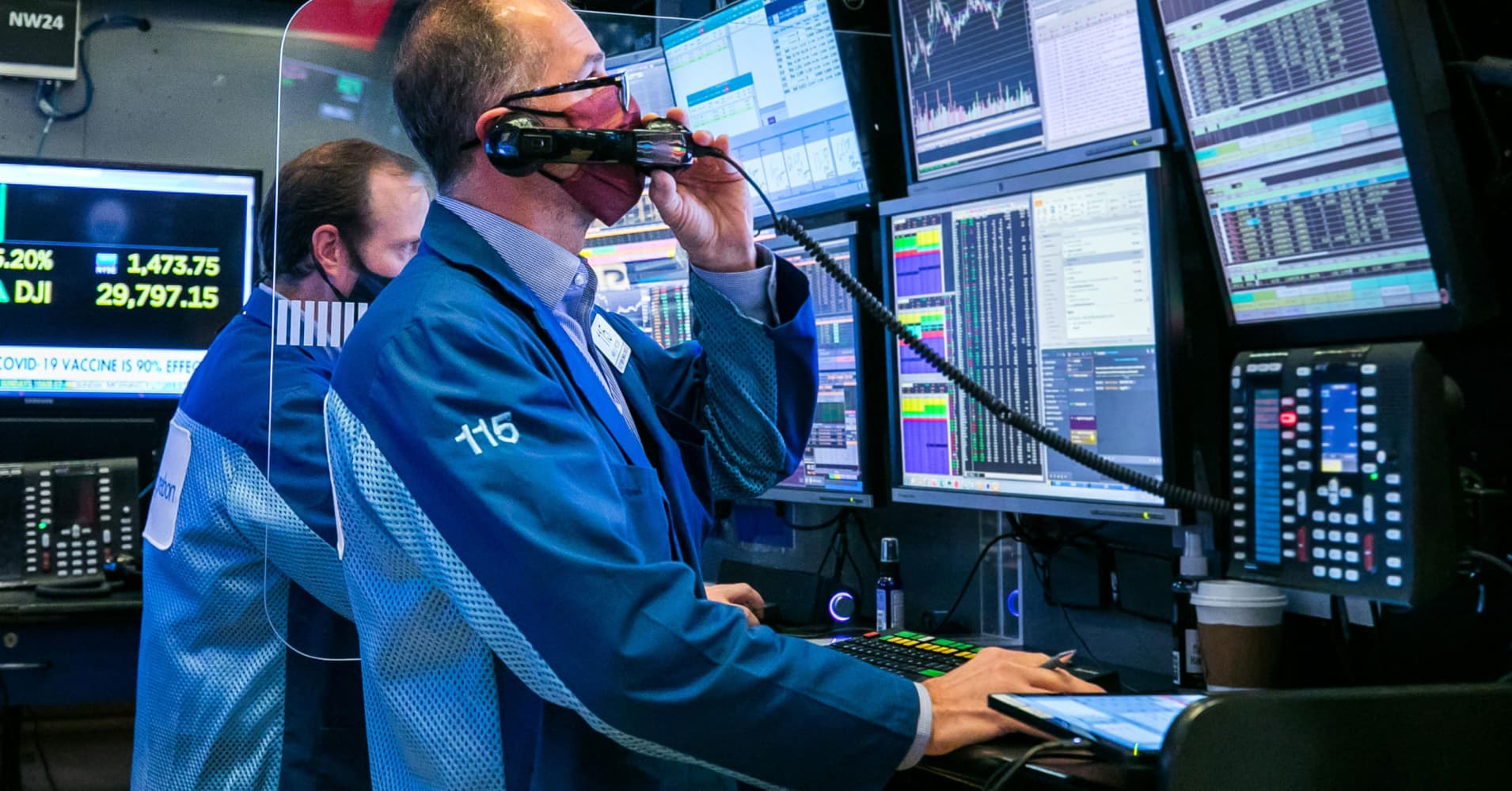 a person using a laptop: U.S. stock futures rose early Friday after another record-breaking session on Wall Street. CNBC's Rahel Solomon reports.
