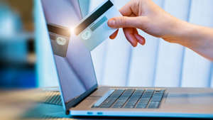 "a close up of a person using a laptop: ""The pandemic helped consumers reevaluate spending in terms of what they needed, versus what they wanted,"" said Angela Holliday, president of Frost Brokerage Services, Inc. and Frost Investment Services, LLC. ""With this in mind, take a look at how you managed to cut costs in 2020 and apply that where you can in 2021. Then, use the extra cash towards paying off your debt. This will help you continue good habits so you can prosper in the new year."" Getting Ahead: A Month-by-Month Guide for Your 2021 Financial Check-Ins"