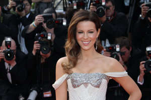 "a group of people posing for the camera: You have to assume that most of actor Kate Beckinsale's Instagram followers are familiar with (and fans of) her irreverent sense of humor. The Underworld star's feed is full of memes, silly selfies, and pets in elaborate costumes. Even the occasional glamor shot is usually accompanied by a gross admission or self-deprecating joke. But it seems that not everyone on her social media is happy with her content. Earlier this week, Kate Beckinsale slammed a fan who demanded that she post more ""beautiful pictures"" of herself. Keep reading to find out what prompted the brazen request and how the actor shut it down. And for more social media clapbacks, check out Serena Williams' Husband Defends Her Against Body Shaming Comment.Read the original article on Best Life."