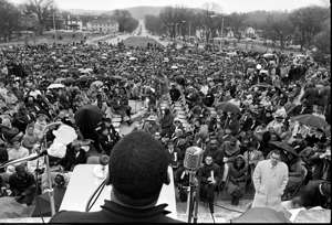 a large crowd of people: Martin Luther King Jr. speaks during a march on Frankfort in March 1964.