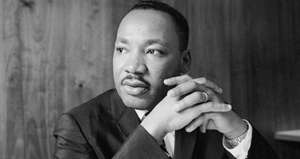 Martin Luther King, Jr. wearing a suit and tie: Dr. Martin Luther King Jr.