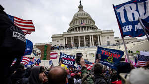 a group of people around each other: WASHINGTON, DC - JANUARY 06: Pro-Trump supporters storm the U.S. Capitol following a rally with President Donald Trump (Photo by Samuel Corum/Getty Images)