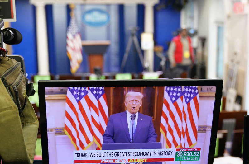 An image of US President Donald Trump speaking in a video released on YouTube is seen on a monitor in the Brady Briefing Room of the White House in Washington, DC, on January 19, 2021. - Trump delivered his farewell address to the nation via a video released on YouTube. (Photo by MANDEL NGAN / AFP) (Photo by MANDEL NGAN/AFP via Getty Images)
