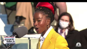 a man wearing a suit and tie: Inaugural poet Amanda Gorman, the Youth Poet Laureate of 2017, delivers a poem at President Joe Biden's inauguration.