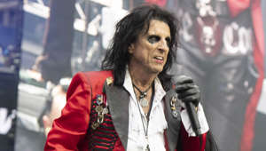 "Alice Cooper talking on a cell phone: Whilst many people think that Alice Cooper killed a chicken on stage during a concert, Cooper himself has a different version of events. The rocker insists he mistakenly believed chickens could fly so when a chicken was thrown at him he simply threw it back and it was the audience who did the damage. He said: ""I took the chicken and tossed it, thinking it had feathers, it should fly. Well, it didn't fly as much as it plummeted. The audience tore it to pieces."""