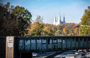 "a close up of a bridge: The CSX bridge that carries trains over the Capital Beltway in Maryland was tagged with graffiti that echoes graffiti that popped up in the 1970s and read ""Surrender Dorothy."" The new message is ""Surrender Donald."""