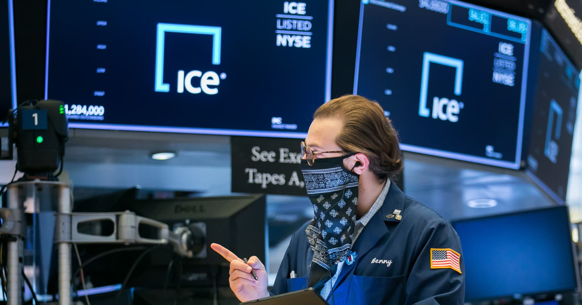 a man standing on a stage: Contracts tied to the major U.S. stock indexes slipped early Friday morning as Wall Street appeared headed to close out the record-setting week on a muted note. CNBC's Rahel Solomon reports.