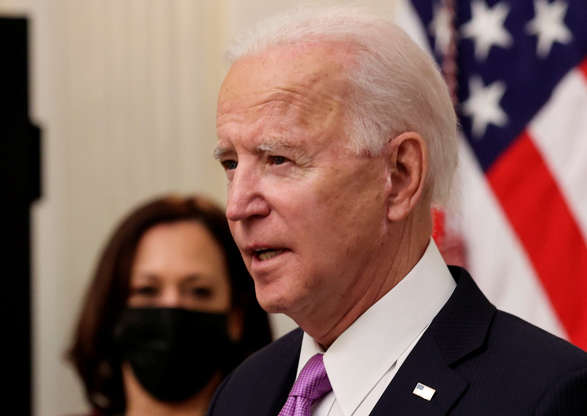 U.S. President Joe Biden speaks about his administration's plans to fight the coronavirus disease (COVID-19) pandemic during a COVID-19 response event as Vice President Kamala Harris listens at the White House in Washington, U.S., January 21, 2021. REUTERS/Jonathan Ernst