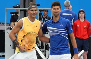 Rafael Nadal, Novak Djokovic are posing for a picture: Rafael Nadal, 33, and Novak Djokovic, 32, have been neck and neck throughout their careers. In 54 matches, Djokovic has the slight lead with 28 wins, but Nadal has the advantage when it comes to Grand Slam meetings, with a 9-6 record. The Spaniard also has two more career Grand Slam titles (18), though at the rate Djokovic is going, that could soon change. In March 2019, Djokovic said of Nadal and Federer: