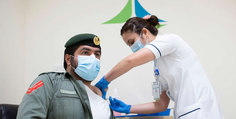 Slide 2 of 126: A man receives a dose of a vaccine against the coronavirus disease (COVID-19), in Dubai, United Arab Emirates December 23, 2020. Government of Dubai Media Office/Handout via REUTERS ATTENTION EDITORS - THIS PICTURE WAS PROVIDED BY A THIRD PARTY.