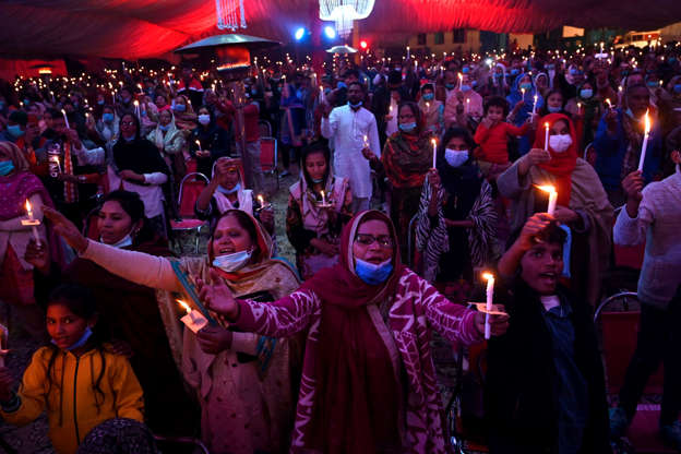 Slide 1 of 126: Christian devotees take part in a special service ahead of Christmas celebrations in Lahore on December 23, 2020. (Photo by Arif ALI / AFP) (Photo by ARIF ALI/AFP via Getty Images)