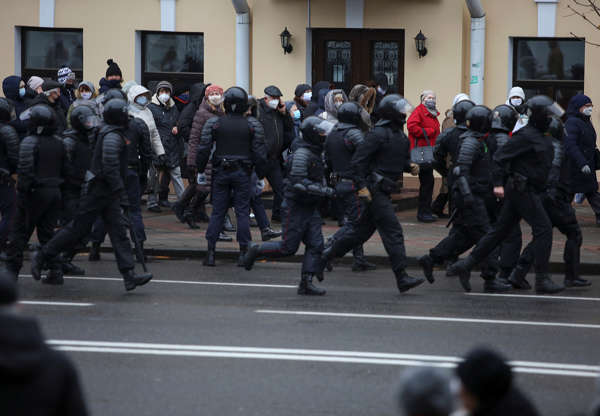 Belarusian law enforcement officers follow participants of an opposition rally, who demand the resignation of Belarusian President Alexander Lukashenko and protest against police violence in Minsk, Belarus November 30, 2020. REUTERS/Stringer