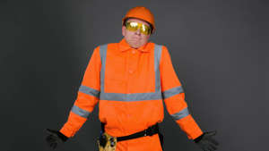 a man wearing a hat: energy asx share price flat represented by worker in hi vis gear shrugging