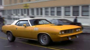 a car parked in front of a building: image credit: Internet Movie Cars Database