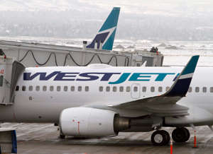 a large passenger jet sitting on top of a runway: 9. WestJet (Canada)