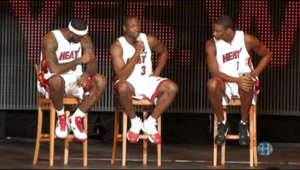 a group of people on a stage: Miami welcomes the three kings of the Miami Heat as Lebron James, Dwyane Wade, and Chris Bosh join the NBA team in a spectacular show at AmericanAirlines Arena on Friday night.    Chuck Fadely  / Miami Herald Staff