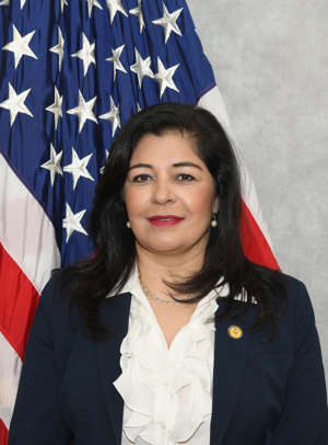 a person posing for the camera: After Feb 1, 2021, Saima Mohsin will become Acting United States Attorney for the Eastern District of Michigan. She has been the First Assistant United States Attorney, a non-political position, since March 2018. She is a career prosecutor, having served in the U.S. Attorney's Office since 2002. Prior to that, she was a Deputy New Jersey Attorney General and an Assistant District Attorney in Manhattan. An immigrant from Pakistan, she is the first Muslim to lead the U.S. Attorney's Office in the Eastern District of Michigan. She is believed to be the first U.S. Attorney nationally to be Muslim, said the U.S. Attorney's office in Eastern Michigan and Muslim advocates