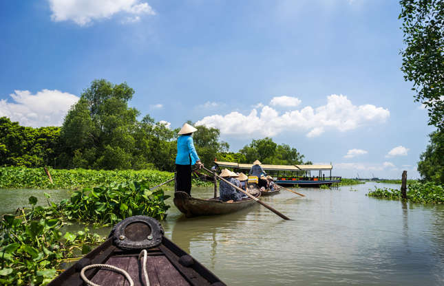 Slide 4 of 21: Located in the middle of the Mekong Delta, the city of Can Tho is crossed by several canals. One primary attraction is its network of boat-accessible floating markets. Numerous cruises and excursions are also available to tourists looking to explore the city by water.