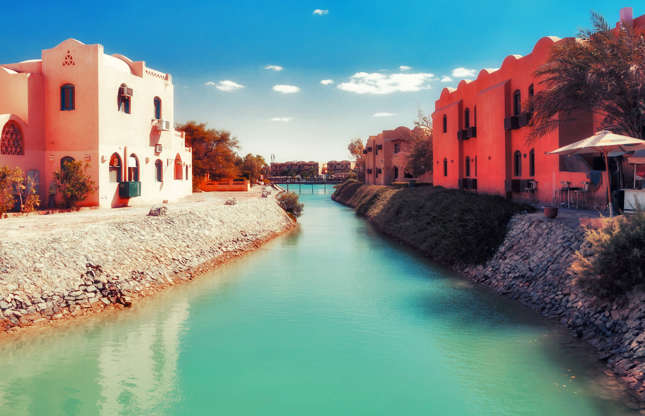 Slide 15 of 21: El Gouna was built around lagoons and canals by billionaire Onsi Sawiris. Composed of 20 islands and designed for vacationers, this city boasts numerous beaches, but you can only get around by boat, tuk-tuk, or small bus.