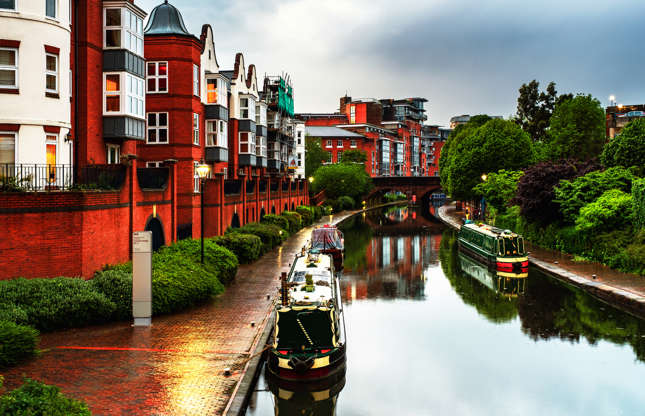 Slide 18 of 21: Birmingham's canals were primarily used for commerce during the Industrial Revolution. Commercial activities stopped in 1980, and the canals were renovated and improved for the enjoyment of residents and tourists.