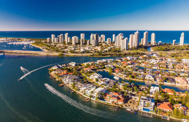 Slide 20 of 21: Gold Coast's network of residential canals date back to 1950. Running alongside the Pacific coast, they are a popular tourist destination. In fact, visitors can choose from several cruises to tour the city, enjoy the landscapes, and appreciate the mild weather.