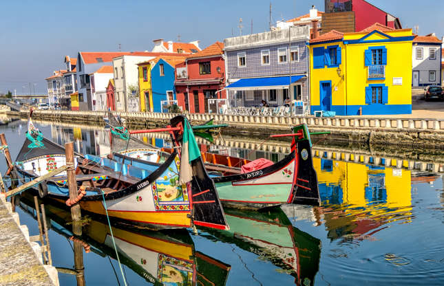 Slide 13 of 21: This small Portuguese city prospered thanks to fishing and salt production. The canals that traverse Aveiro connect to lagoons and beaches, and a trip aboard a Moliceiro (Aveiro's unique coloured boats) provides a nice view of the city's architecture and landscapes.