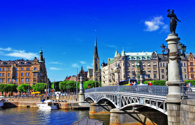 """Slide 5 of 21: Sweden's capital is composed of 14 islands connected by 57 bridges, earning it the nickname """"Venice of the North."""" Take a guided boat tour or admire Stockholm's architecture with a visit to the city hall, royal palace, and other sites."""