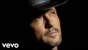"a close up of a man wearing a hat: Humble and Kind is off Tim's album DAMN COUNTRY MUSIC:  http://smarturl.it/DamnCountryMusic  Get the ""Humble and Kind"" book now where ever books are sold. http://mcgr.aw/245XQwR  Music video by Tim McGraw performing Humble And Kind. (C) 2016 McGraw Music, LLC under exclusive license to Big Machine Label Group, LLC  http://vevo.ly/bH6u9q Best of TimMcGraw: https://goo.gl/vtfr8x Subscribe here: https://goo.gl/KxDM94"