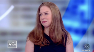 a close up of Chelsea Clinton: Hillary, Chelsea Clinton to produce series about all-women militias that fought Islamic State