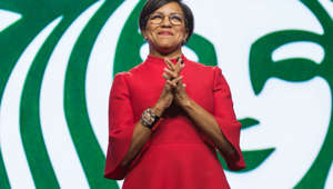 Rosalind Brewer holding a sign posing for the camera: Starbucks Chief Operations Officer and Group President Rosalind