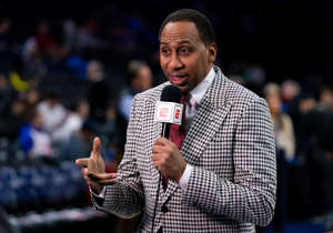 Stephen A. Smith wearing a suit and tie: ESPN analyst Stephen A. Smith broadcasts before a game between the Philadelphia 76ers and the Miami Heat at Wells Fargo Center.