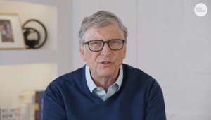 Bill Gates wearing glasses and looking at the camera