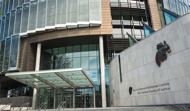 a person standing in front of a building: Defending barrister Mr Mark Lynam said his client met with gardaí by arrangement when he was arrested and interviewed in May 2016. Pic: Education Images/Universal Images Group via Getty Images