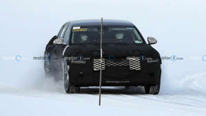 a car covered in snow: Next-generation Genesis G90 spy photo