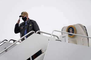President Joe Biden boards Air Force One at Hagerstown Regional Airport, Monday, Feb. 15, 2021, in Hagerstown, Md. President Biden spent the weekend at Camp David.
