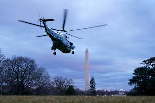 Slide 2 of 14: Marine One, with President Joe Biden aboard, lifts off from the South Lawn of the White House, Tuesday, Feb. 16, 2021, in Washington. Biden is traveling to Milwaukee to participate in a town hall event.
